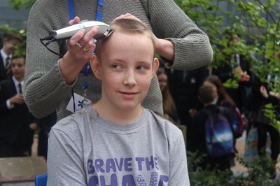 Ethan Braves the Shave in front of whole school